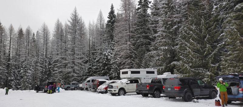 Truck camper parked in a ski resort parking lot