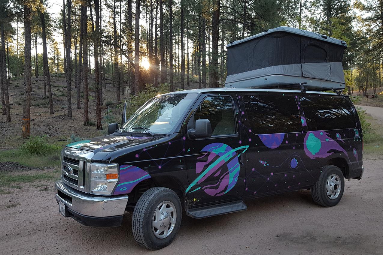 Rental camper van with pop-up tent.