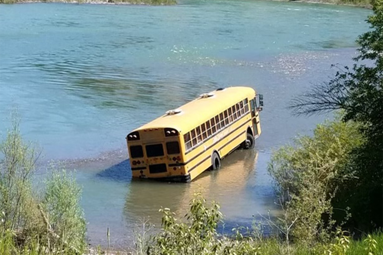 Bus stuck in the river.