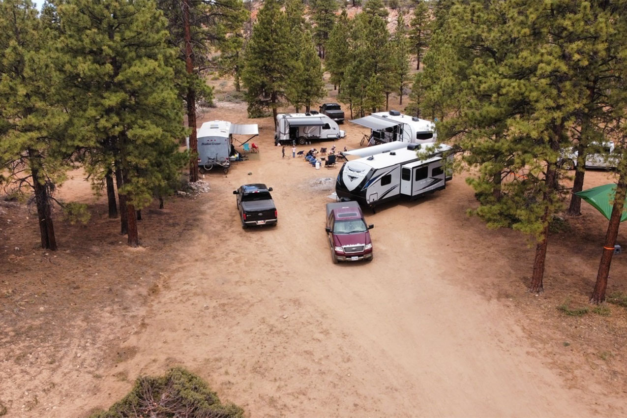 Several RVs parked in a circle in the high desert.