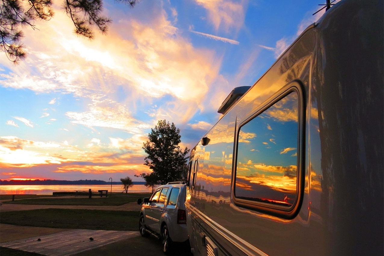 Sunset and clouds reflected in the window of RV windows.